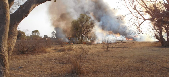 In this photo made available by the Nigerian Military taken Tuesday, April 28, 2015, an Islamic extremist camp burns after it was allegedly destroyed by Nigerian military personnel during a attack on Islamic extremists positions in the Sambisa Forest, Nig