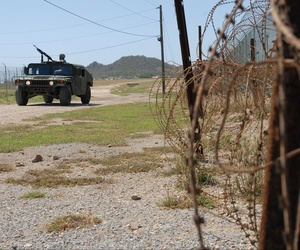 A Humvee from the Puerto Rico Army National Guard's, 480th Military Police Company, patrols the perimeter of the detention facility at Guantanamo Bay Naval Base, Cuba.