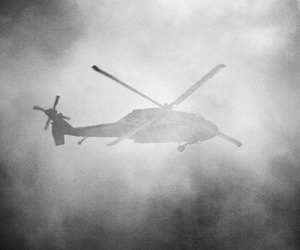 A United States Army Sikorsky UH-60 Blackhawk flies behind a cloud of smoke during the Combined Arms Demonstration at the Rhode Island National Guard Open House and Airshow, held at Quonset State Airport (KOQU/OQU) in North Kingstown, RI.