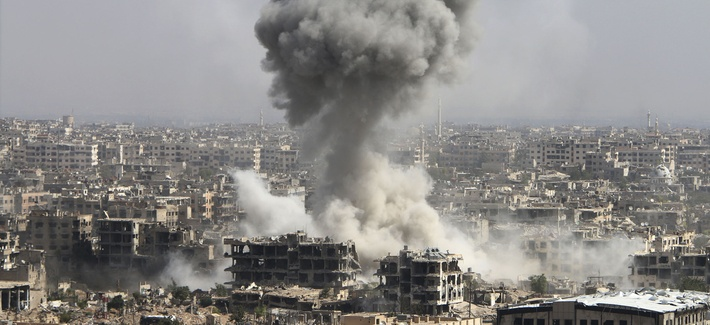 In this photo taken on Wednesday, Oct. 14, 2015, smoke rises after shelling by the Syrian army in Jobar, Damascus, Syria.