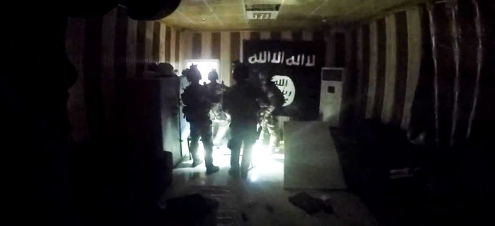This image made from video taken on Thursday, Oct. 22, 2015 from a helmet camera, shows U.S. and Iraqi special forces inside a makeshift prison in the town of Huwija, 15 kilometers (9 miles) west of the Iraqi city of Kirkuk.