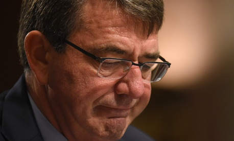 Defense Secretary Ash Carter pauses while testifying on Capitol Hill in Washington, Tuesday, Oct. 27, 2015, before the Senate Armed Services Committee.