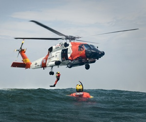 Rescue swimmers and aircrewmen from Coast Guard Air Station Cape Cod, Mass., conduct hoist training evolutions June 23, 2015.