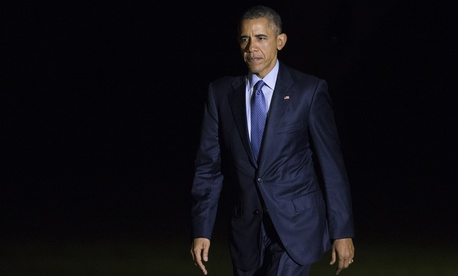 President Barack Obama walks to the White House after arriving on the South Lawn, on Tuesday, Nov. 3, 2015, in Washington.