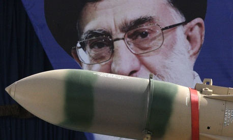 In this Thursday, April 18, 2013 file photo, a Yaser missile is displayed by the Iranian army in front of a portrait of supreme leader Ayatollah Ali Khamenei during a parade marking National Army Day.