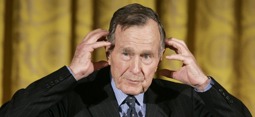 Former President George H.W. Bush gestures while telling a story as he speaks during a presentation ceremony for the Hugh S. Sidey Scholarship in Print Journalism, during a ceremony in the East Room of the White House in Washington Friday, Jan. 26, 2007.