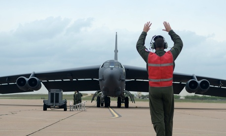 A U.S. Air Force airman marshals a B-52H Stratofortress bomber.