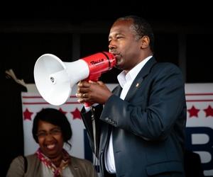 Ben Carson uses a megaphone during a speech.