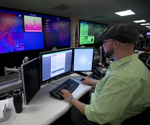 A specialist works at the National Cybersecurity and Communications Integration Center (NCCIC) in Arlington, Va., Tuesday, Sept. 9, 2014.