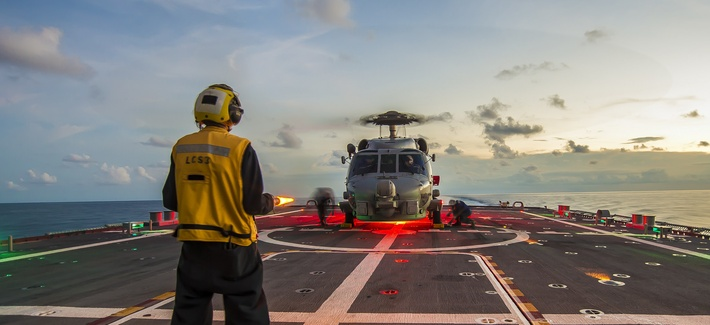 SOUTH CHINA SEA (April 30, 2015) Sailors assigned to LCS Crew 103 chock and chain an MH-60R Seahawk helicopter, from Helicopter Maritime Strike Squadron (HSM) 35, on the flight deck aboard the littoral combat ship USS Fort Worth (LCS 3).
