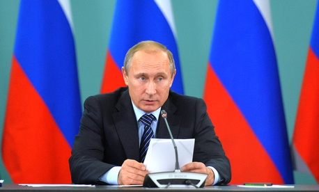 Russian President Vladimir Putin speaks during his late-night meeting with the heads of Russia's sports federations in the Black Sea resort of Sochi, Russia, Wednesday, Nov. 11, 2015.