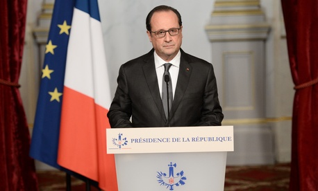 French President Francois Hollande speaks at the Elysee Palace in Paris, Saturday, Nov. 14, 2015, following a series of coordinated attacks in and around Paris late Friday which left more than 120 people dead.