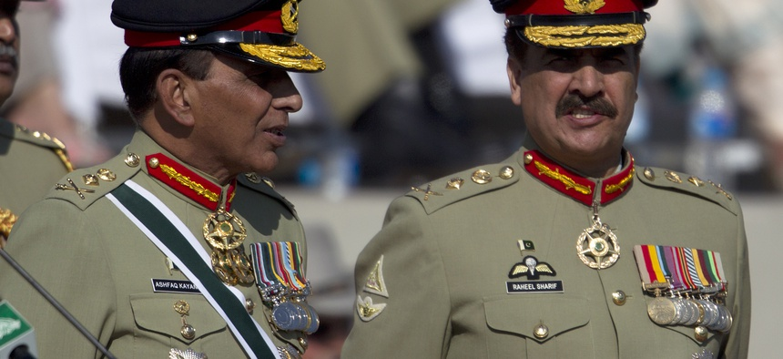 Pakistan's outgoing army chief Gen. Ashfaq Kayani, left, talks with his successor Gen. Raheel Sharif at a command changing ceremony in Rawalpindi, Pakistan, Friday, Nov. 29, 2013.