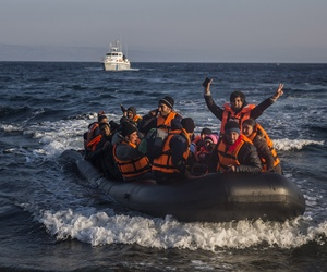 Refugees and migrants arrive safely on a dinghy from the Turkish coast to the northeastern Greek island of Lesbos on Tuesday, Nov. 17, 2015.