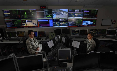 Staff Sgt. Alex Garviria and 2nd Lt. Rachel James work in the Global Strategic Warning and Space Surveillance System Center Sept. 2, 2014, at Cheyenne Mountain Air Force Station, Colo.