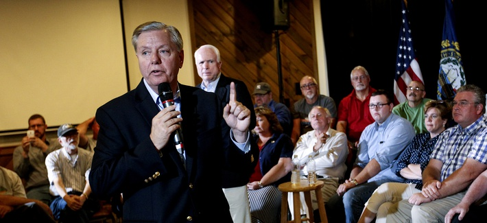 Republican presidential candidate Sen. Lindsey Graham (R-S.C.), front center, campaigns with Sen. John McCain, R- Ariz, back center, as they hold a town hall meeting in Manchester, N.H., Saturday, Aug. 1, 2015.