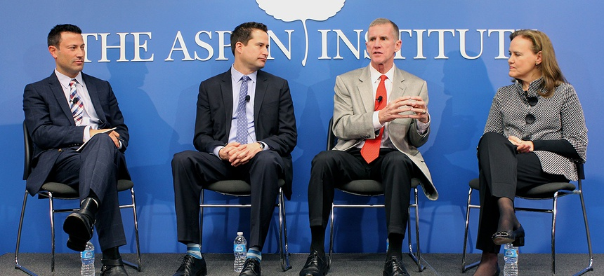 Retired Gen. Stanley McChrystal, center right, at a panel discussion on national service with Rep. Seth Moulton (center left) and Michele Flournoy (right) of the Center for a New American Security. Kevin Baron, far left, of Defense One moderated.