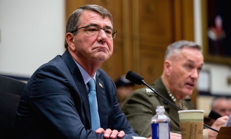 Joint Chiefs Chairman Gen. Joseph Dunford Jr. accompanied by Defense Secretary Ash Carter, testifies on Capitol Hill in Washington, Tuesday, Dec. 1, 2015.
