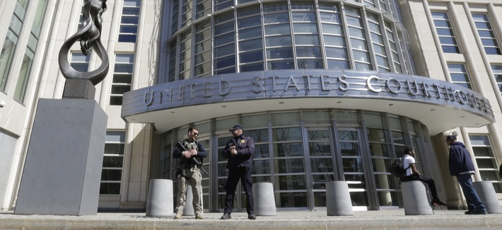 Heavily armed U.S. Marshals stand guard outside federal court Thursday, April 2, 2015, in the Brooklyn borough of New York.