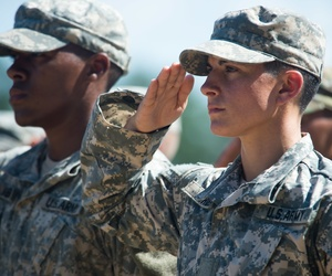 Capt. Kristen Griest and U.S. Army Ranger School Class 08-15 render a salute during their graduation at Fort Benning, Ga., Aug. 21, 2015.
