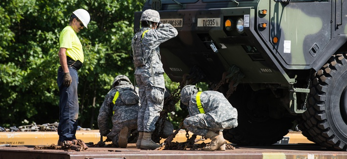 Soldiers of the 10th Mountain Division work with a civilian during railhead operations at Fort Drum, N.Y., July 28, 2015.