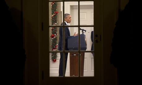 President Barack Obama addresses the nation from the Oval Office at the White House in Washington, Sunday night, Dec. 6, 2016.
