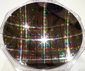A quantum computing chip at the 2014 In-Q-Tel CEO Summit .
