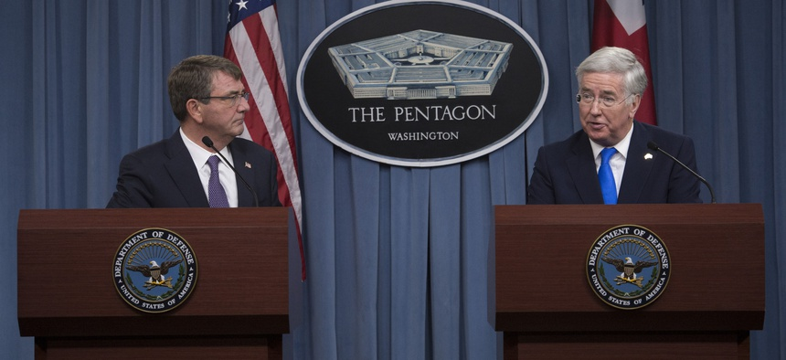 U.S. Defense Secretary Ash Carter and British Defense Secretary Michael Fallon conduct a joint news conference at the Pentagon, Dec. 11, 2015.