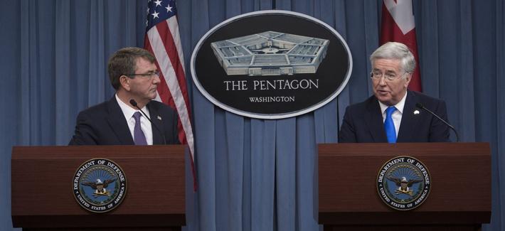 U.S. Defense Secretary Ash Carter and British Defense Secretary Michael Fallon conduct a joint news conference at the Pentagon, Dec. 11, 2015.