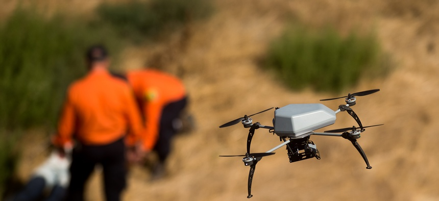 A drone flies over a ravine as the Alameda County Sheriff's Office demonstrates a search and rescue operation, Friday, Aug. 14, 2015, in Dublin, Calif.