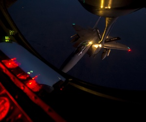 A U.S. Air Force F-15E Strike Eagle aircraft refuels from a KC-135 Stratotanker aircraft over northern Iraq Sept. 23, 2014, after conducting airstrikes in Syria.
