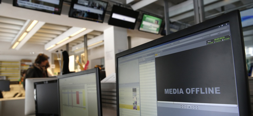 Computer screens are pictured at TV5 Monde after the French television network was hacked by people claiming allegiance to the Islamic State group, in Paris, France, Thursday April 9, 2015.