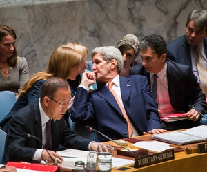 Secretary of State John Kerry speaks with the U.S. Ambassador to the UN, Samantha Power, during the UN Security Council meeting on Syria on Dec. 18.