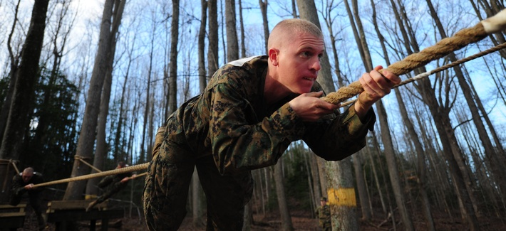 A Marine Officer Candidates School troop maneuvers down a horizontal rope on Dec. 9, 2011, at Marine Corps Base Quantico, Va.