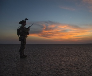 A Joint Terminal Attack Controller controls an HC-130J Combat King II from the 81st Expeditionary Rescue Squadron at Grand Bara, Djibouti, Oct. 20, 2015.