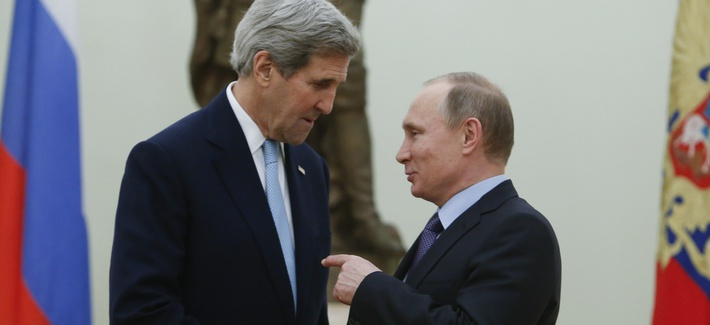 Russian President Vladimir Putin, right, speaks with U.S. Secretary of State John Kerry during their meeting in the Kremlin in Moscow, Russia, Tuesday, Dec. 15, 2015.