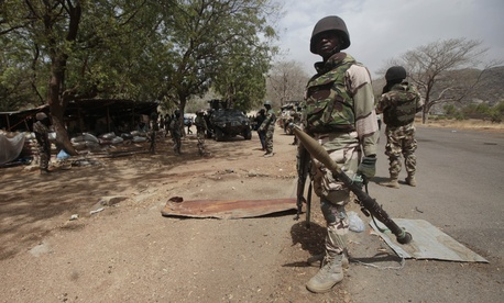Nigerian soldiers man a checkpoint in Gwoza, Nigeria, a town newly liberated from Boko Haram, April 8, 2015.
