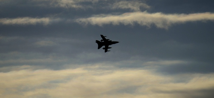 A British Tornado warplane flies over the RAF Akrotiri, a British air base near costal city of Limassol, Cyprus, Thursday, Dec. 3, 2015, as it arrives from an airstrike against Islamic State group targets in Syria.