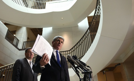 House Homeland Security Committee Chairman Rep. Michael McCaul, R-Texas, right, accompanied by Rep. Richard Hudson, R-N.C., speaks to reporters on Capitol Hill in Washington, Friday, Jan. 8, 2016, about the arrest of two Iraqi-born men.
