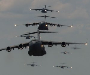 U.S. Airmen from Joint Base Charleston, S.C., conduct a multi-ship C-17 Globemaster III formation on May 21, 2015.