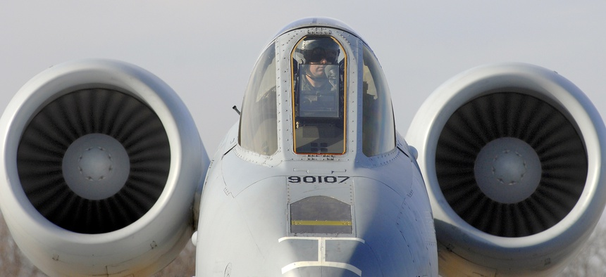 A pilot with the 442nd Fighter Wing sits on the ramp in a U.S. Air Force A-10 Thunderbolt II aircraft while crew chiefs perform a hot pit refuel for his aircraft at Whiteman Air Force Base, Mo., Dec. 8, 2010.