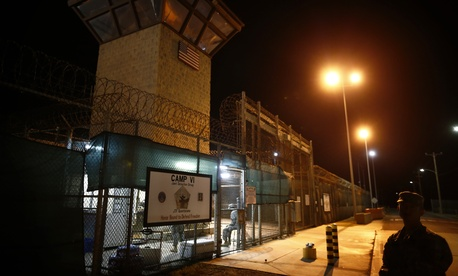 In this image reviewed by the U.S. military, the entrance to Camp VI detention facility is guarded at Guantanamo Bay Naval Base, Cuba, Wednesday, Nov. 20, 2013.