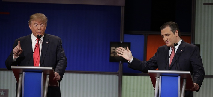 Republican presidential candidate Donald Trump speaks as Sen. Ted Cruz, R-Texas, looks on during the Fox Business Network Republican presidential debate, Jan. 14, 2016, in North Charleston, S.C.