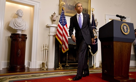 President Barack Obama leaves the podium after speaking about the release of Americans by Iran, Sunday, Jan. 17, 2016, in the Cabinet Room of the White House in Washington.