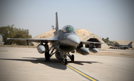Two of four new U.S.- made F-16 fighter jets stand on the tarmac upon their arrival to Balad air base, 75 kilometers (45 miles) north of Baghdad, Iraq, Monday, July 13, 2015.