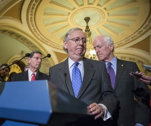 Senate Majority Leader Mitch McConnell, R-Ky., center, joined at right by Majority Whip John Cornyn, R-Texas, and at rear left by Sen. John Barrasso, R-Wyo.,  at the Capitol in Washington, Jan. 20, 2016.