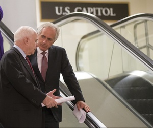 Sen. John McCain, R-Ariz., left, and Sen. Bob Corker, R-Tenn., right, at the Capitol in Washington, Tuesday, Sept. 17, 2013.