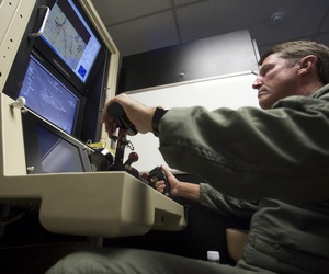A U.S. Air Force officer pilots a training simulator for the MQ-1 Predator, at the March Air Reserve Base in Riverside County, Calif., June 25, 2008.