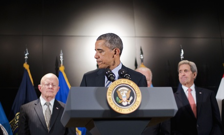 President Barack Obama, accompanied by, from left, Office of National Intelligence Director James Clapper, VP Joe Biden, and State Secretary John Kerry, ends his remarks at the National Counterterrorism Center in McLean, Va., Dec. 17, 2015.