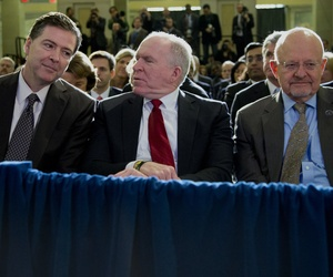 From left, FBI Director James Comey, CIA Director John Brennan, and Director of National Intelligence James Clapper sit together in the front row before President Barack Obama spoke about National Security Agency (NSA) surveillance, Friday, Jan. 17, 2014,